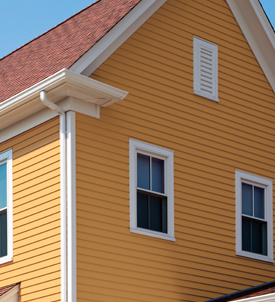 Yellow house with Apex Siding
